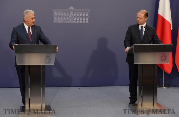 Prime Minister Joseph Muscat (right) and his Turkish counterpart, Prime Minister Binali Yildirim glance across at each other whilst answering questions from the press at Castille on February 17. Photo: Matthew Mirabelli