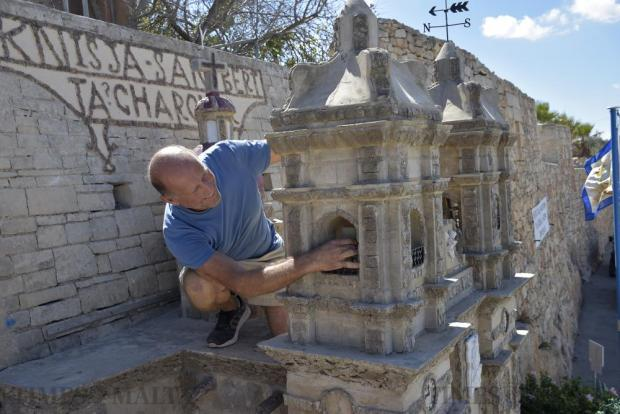 Victor Camilleri checks the replica of Għargħur's parish church, dedicated to St Bartholomew and made out of stone, pebbles and shells, in Gharghur on September 8. Photo: Mark Zammit Cordina
