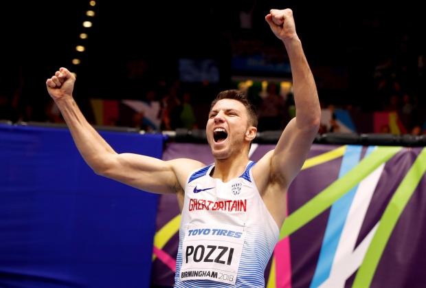Andrew Pozzi celebrates his victory at the world indoors in Birmingham.