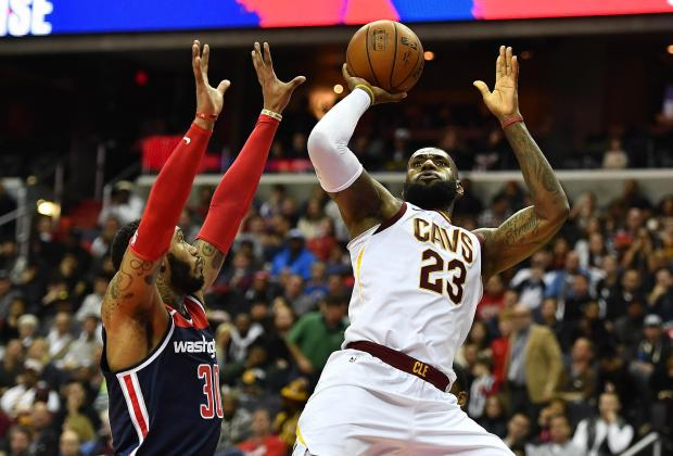 Cleveland Cavaliers forward LeBron James (23) shoots over Washington Wizards forward Mike Scott (30) during the first half at Capital One Arena. Photo: Brad Mills-USA TODAY Sports