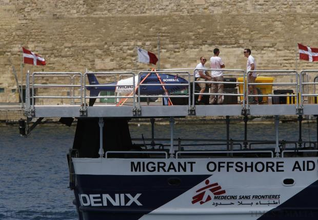 Crew members stand next to a Schiebel Camcopter S-100 drone on board the Migrant Offshore Aid Station (MOAS) ship MV Phoenix as it sails out of Valletta's Grand Harbour on May 2. The 40-metre ship MV Phoenix, manned by personnel from international non-governmental organisations Medecins san Frontiere (MSF) and MOAS, left Malta for a six-month mission to search for and rescue migrants in the Mediterranean. The Phoenix is the first privately funded vessel to operate in the Mediterranean. Photo: Darrin Zammit Lupi