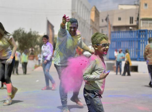 A man throws coloured powder paint during the Holi Festival organised by the Indian Community held in St Venera on April 06.