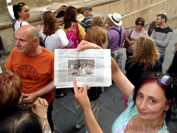 A crowd gathers to mourn Masha on May 24. The beloved cat euthanized by Animal Welfare last week who for 18 years had been fed and photographed by passers-by as she sat atop a utility box in Valletta. Photo: Chris Sant Fournier