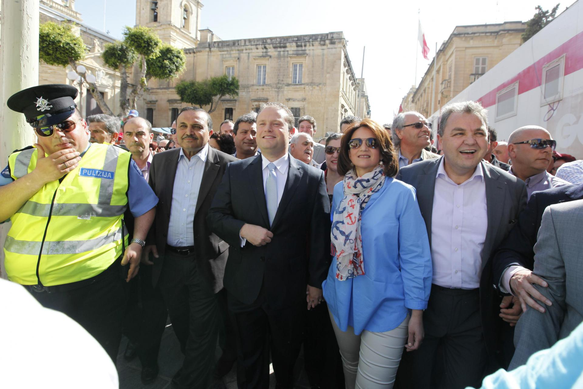 Joseph Muscat and his wife Michelle lead May Day celebrations in 2012, flanked by party deputy leaders Toni Abela (left) and Anglu Farrugia (right).