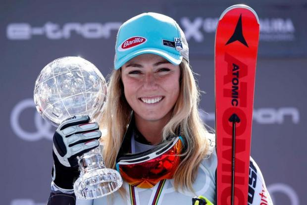 Mikaela Shiffrin of the US celebrates with the trophy.
