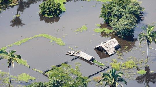 An aerial view of a flooded farm in the northeastern state of Maranhao. A bout of extreme weather, including floods in the north and drought in the south, has reignited the debate about how climate change is affecting Latin America's largest country, home to the world's biggest rain forest and one of the world's bread baskets.