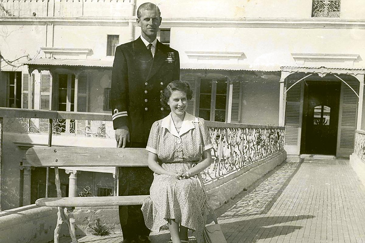 Prince Philip and the then-Princess Elizabeth pose outside Villa Guardamangia. The British press interpreted Philip's two fingers as a hint that they were expecting their second child. Photo: Frank Attard