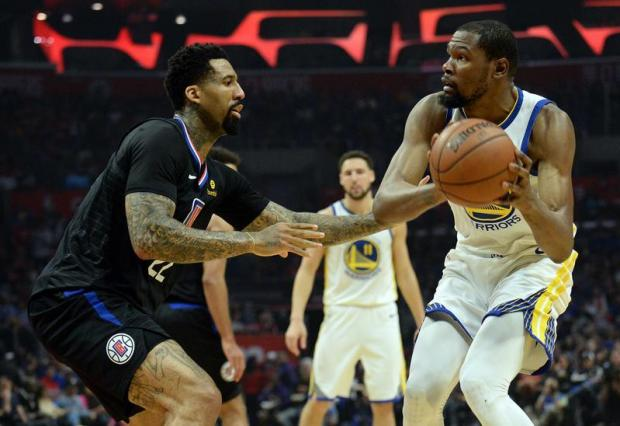 Golden State Warriors forward Kevin Durant (35) controls the ball against Los Angeles Clippers forward Wilson Chandler (22) during the first half in game four of the first round of the 2019 NBA Playoffs at Staples Center. Mandatory Credit: Gary A. Vasquez-USA TODAY Sports