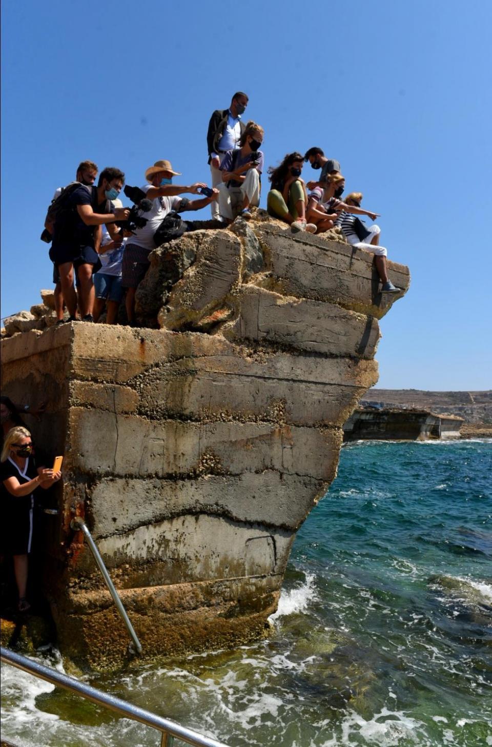 Onlookers take photos as Kim is released into the wild. Photo: Chris Sant Fournier