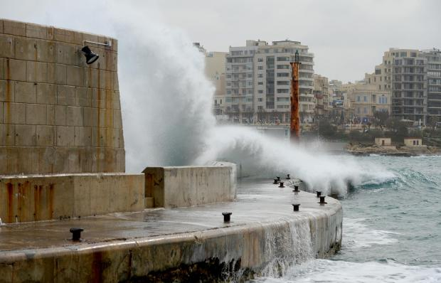 A wave crashes over the breakwater at the entrance to Portomaso Marina as strong winds continued to hit the island on January 4. Photo: Matthew Mirabelli