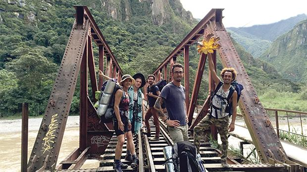 Mark Strijbosch (centre) with friends en route to Machu Picchu, which included miles of trekking, surf, climbing, zip lining and whitewater rafting.