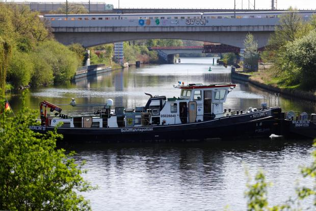 Water police boats block a canal while a World War Two bomb is defused near the central train station in Berlin