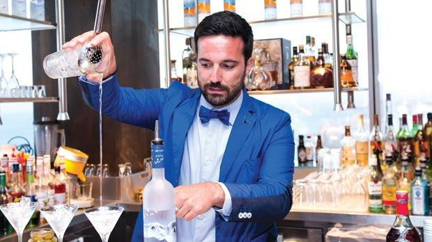 A bartender concocting Grey Goose cocktails during the presentation.