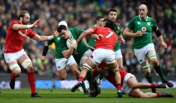 Ireland's James Ryan in action with Wales' Alun Wyn Jones and Josh Navidi.