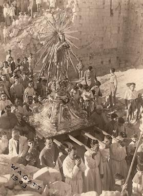 The statue being carried in procession through the streets of war-torn Senglea on September 8, 1943. Photo: Walter Gatt