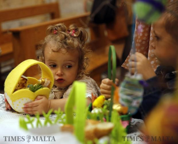 Polish children attend the 'blessing of the Easter baskets', which contain various traditional Easter foods, at St Barbara Church in Valletta on March 26. This is one of the most enduring and beloved Polish traditions every Holy Saturday. Photo: Darrin Zammit Lupi