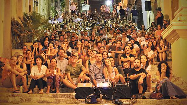 The audience attending Triq Cinemoon Festival in St John Street, Valletta.