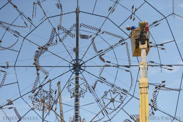 A large Catherine Wheel starts to be dismantled after being used in the weekend's celebrations of the feast of the Annunciation in Tarxien on June 7. Photo: Matthew Mirabelli