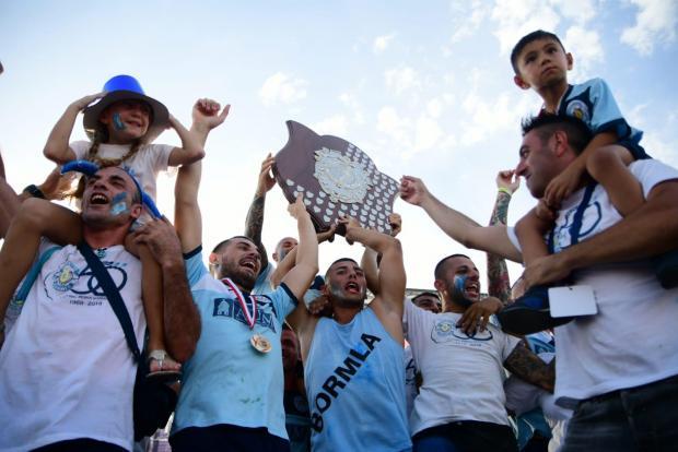 Cospicua celebrating their Victory Day Regatta success. Photo: Jonathan Borg