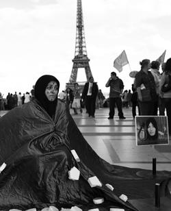 People taking part in a demonstration in front of the Eiffel Tower at the Trocadero esplanade in Paris, France, in support of Sakineh Mohammadi-Ashtiani, 43, sentenced to death by stoning after an Iranian court found her guilty of adultery and complicity in her husband's murder. Photo: Thomas Coex/AFP