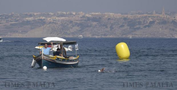 A swimmer is accompanied by a small luzzu on arrival at Marfa on the final stretch of the annual Malta-Gozo-Malta and Gozo-Malta swim on August 27. Photo: Mark Zammit Cordina