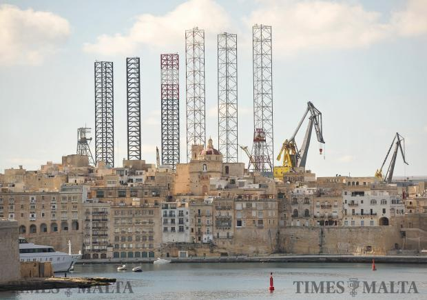 The steel supporting legs of offshore rigs rise high above the Senglea skyline on February 22. Photo: Chris Sant Fournier