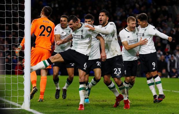 Liverpool's Dejan Lovren and Emre Can celebrate after Ragnar Klavan scored their second goal.