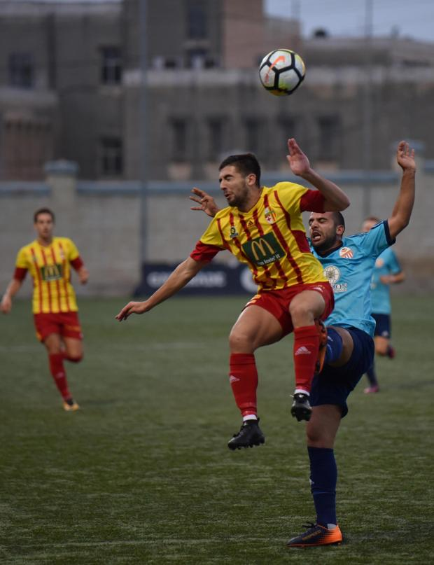 Birkirkara's Cain Attard is fouled from behind by a Lija player in a match held at the Victor Tedesco Stadium in Hamrun on October 20. Photo: Mark Zammit Cordina