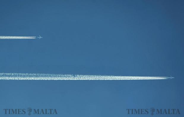Highflying aircraft leave contrails as they fly parallel over Malta on June 8. Photo: Chris Sant Fournier