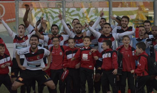Hamrun Spartans players and ball boys celebrate their 2-0 victory over Birkirkara during their Premier League football match at the National Stadium in Ta' Qali on December 4. Photo: Mark Zammit Cordina