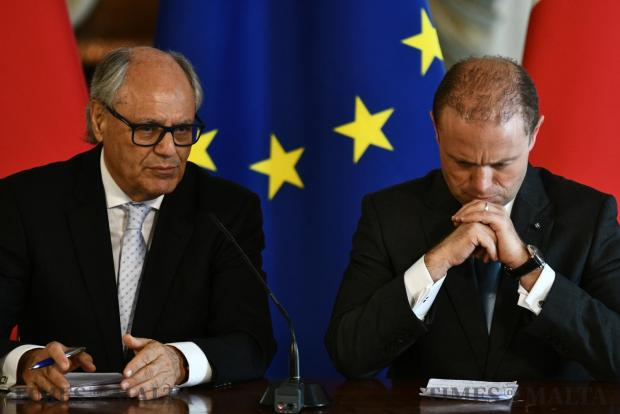 Joseph Muscat and Finance Minister Edward Scicluna, hold a hastily called news conference on May 20. Photo : Jonathan Borg