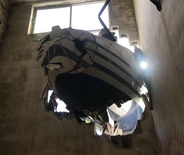 The nose of the aircraft as seen inside the building.