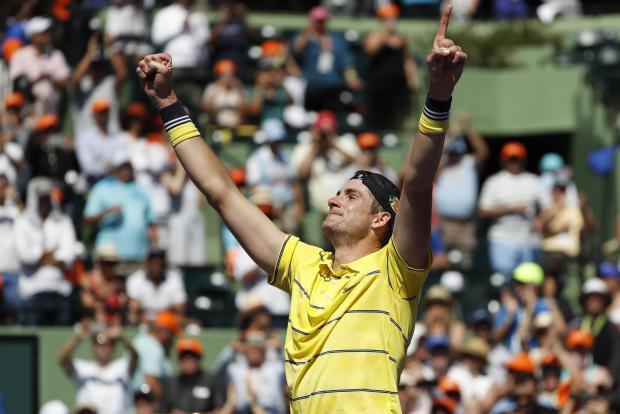 John Isner of the United States reacts after his match against Alexander Zverev of Germany (not pictured) in the men's singles final of the Miami Open at Tennis Center at Crandon Park. 6-7(4), 6-4, 6-4. Photo Credit: Geoff Burke-USA TODAY Sports