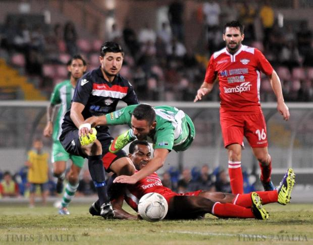 Floriana and Balzan players fight for the ball at the Ta'Qali National Stadium on October 3. The thriller of a match ended in a 1-1 draw. Photo: Chris Sant Fournier