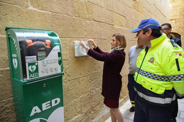 Gozo Minister Justyne Caruana launches the ERRC defibrillator in Victoria.