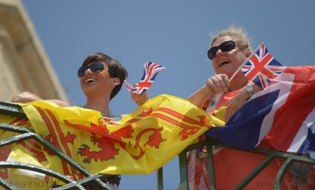 Two ladies wave Union Jack flags during a ceremony to mark the 300th anniversary of the Royal Regiment of Artillery at the Upper Barrakka, in Valletta on July 10. Photo: Matthew Mirabelli
