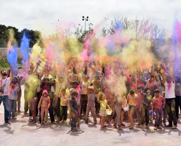 People Throw coloured powder paint into the air during the Holi Festival organized by the Indian Community held in St Venera on April 06. Photo: Mark Zammit Cordina