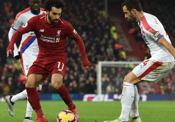Watch: Salah fires Liverpool seven points clear