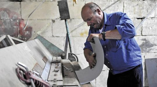 Frans Attard, Il-Kalakku, forming the metal sheets for the body of the bus. Photo: Chris Sant Fournier
