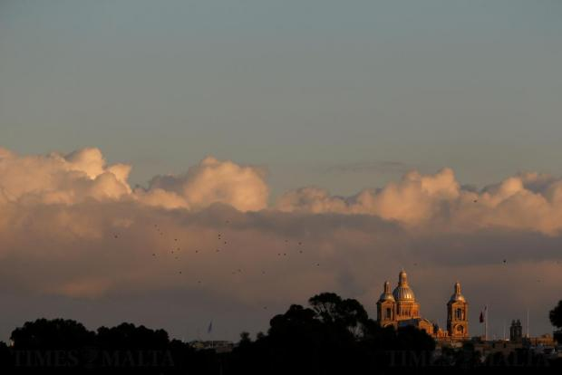A flock of birds flies near the Church of Christ the King in Paola on December 11. Photo: Darrin Zammit Lupi
