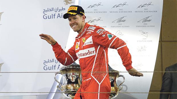 Ferrari's Sebastian Vettel gestures on the podium after winning the Bahrain Grand Prix earlier this month.