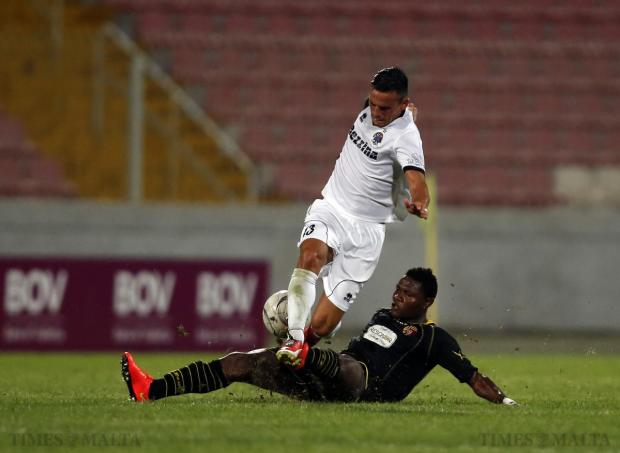 Qormi's Albert Bruce tackles Hibernians' Clayton Failla during their Premier League match at the National Stadium in Ta' Qali on August 24. Photo: Darrin Zammit Lupi