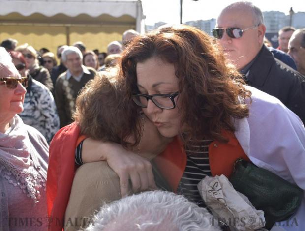 Former Labour Party MP Marlene Farrugia hugs and kisses a Nationalist party supporter at a demonstration in Sliema on February 12. Photo: Mark Zammit Cordina