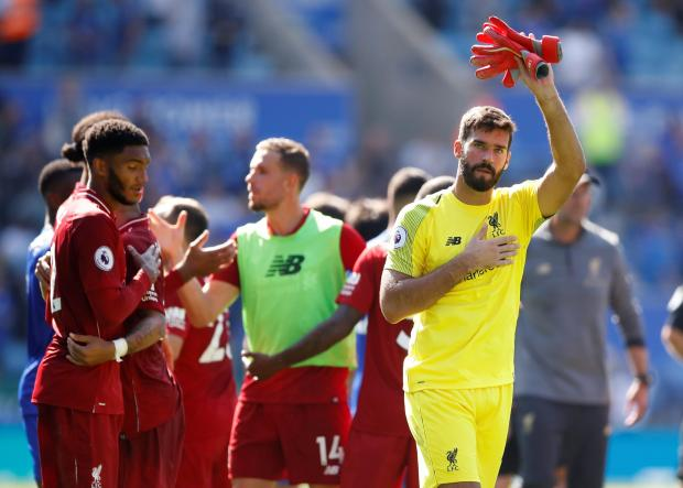Liverpool goalkeeper Allison Becker apologises to his fans at the end of the match.