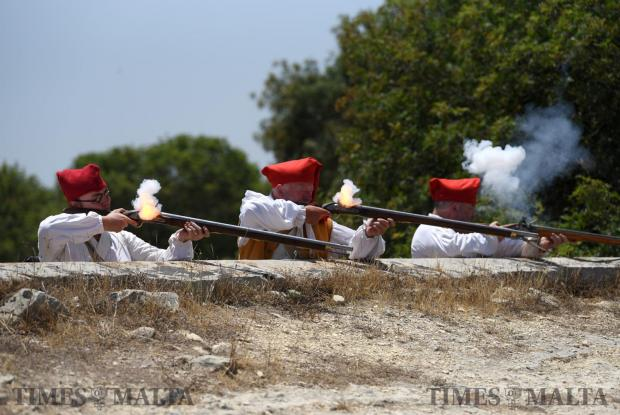 Re-enactors fire guns during a battle in San Maison on June 5. Photo: Mark Zammit Cordina