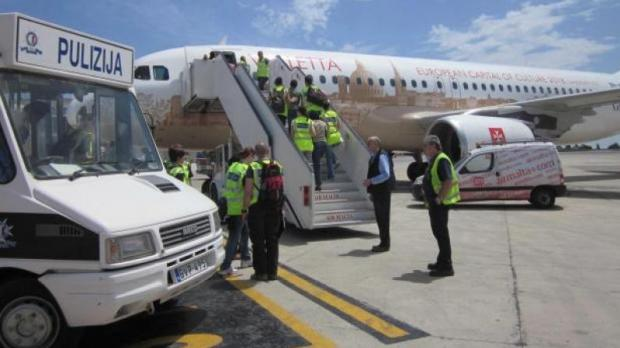 Migrants being repatriated from Malta.