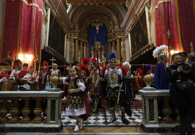 Participants dressed as Roman soldiers wait inside St Philip Church before a Good Friday procession in Zebbug on March 25. Photo: Darrin Zammit Lupi