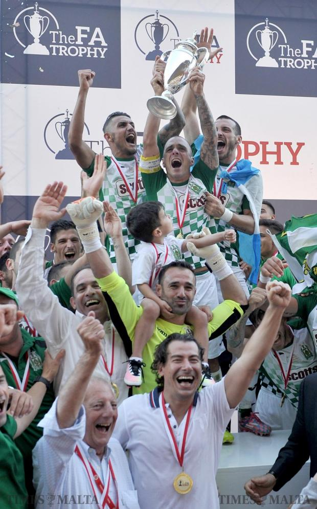 Floriana FC players lift the FA Trophy in jubilation after beating Sliema Wanderers 2-0 at the National Stadium in Ta'Qali on May 20. Photo: Chris Sant Fournier