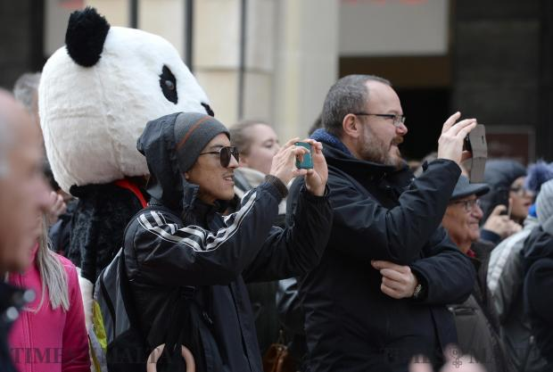 People take photos of the Zhejiang Wu Opera Troupe as they perform in the streets of Valletta celebrating the Chinese New Year on February 13. Photo: Matthew Mirabelli