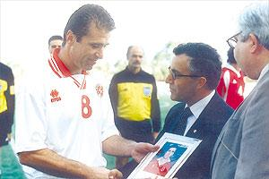 Nicky Saliba (left) receives a memento from Carmelo Bartolo, the MFA senior vice-president, before his final appearance for the national team in a friendly match against Canada in 2001.
